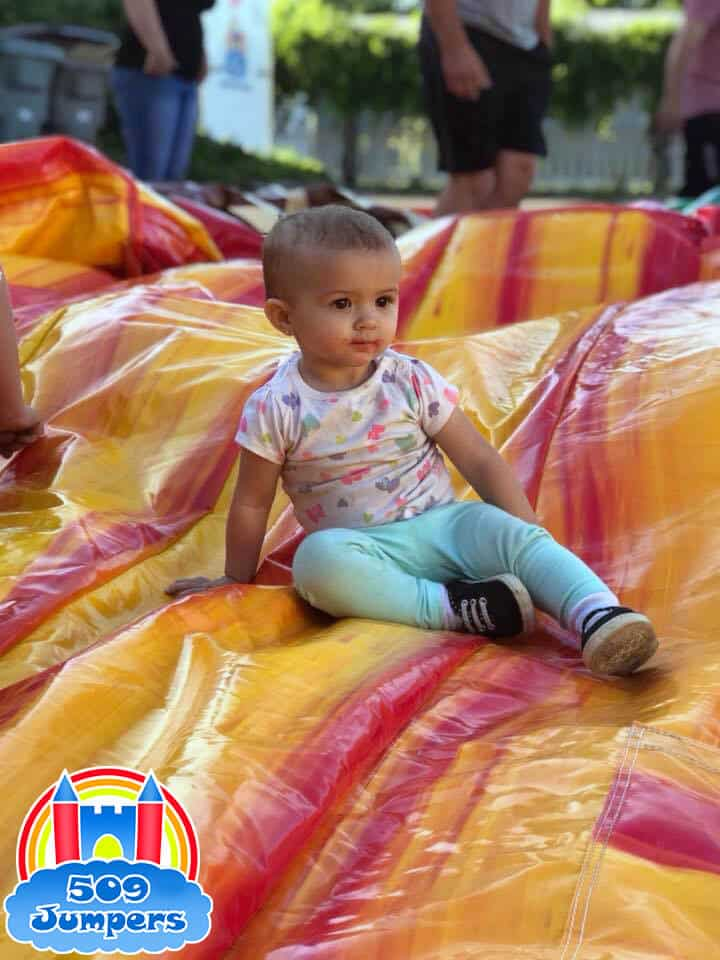 Baby on water slide